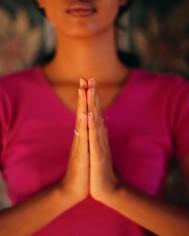 woman in prayer pose