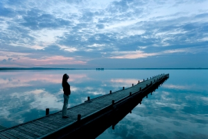 woman standing on a dock